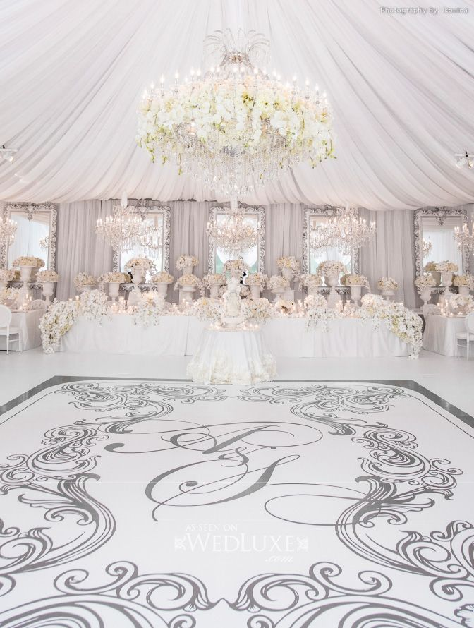 Custom white monogrammed dance floor. Anne Anderson Events + Advanced Tent Rentals.