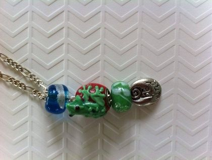 Green and red lamp work frog pendant
