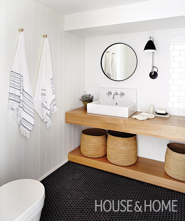 Suzanne's basement bathroom is a study in spare, Scandinavian style with a white oak vanity and white panelled walls.   Photographer: Angus Fergusson  Designer: Arriz + Co. and Suzanne Dimma