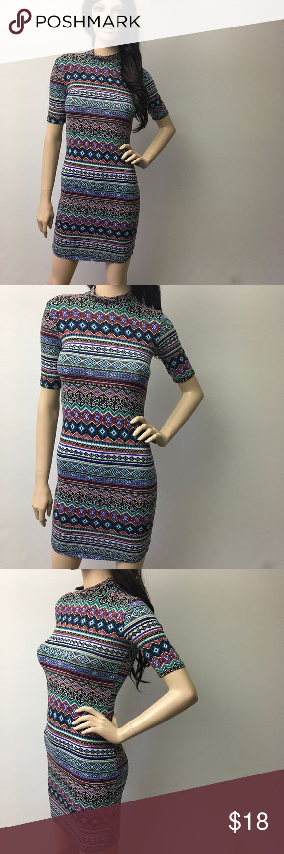 Aztec Bodycon Dress With  Neck This dress is sexy! Stretchy fabric. Bodycon style. It has a small turtle neck.  Forever 21 Dresses