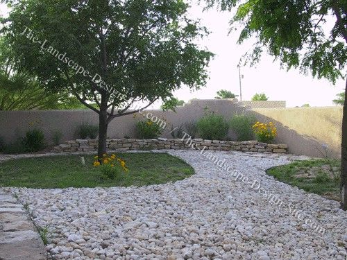 Retaining wall for back yard dry stacked rocks rock for Xeriscaped backyard design