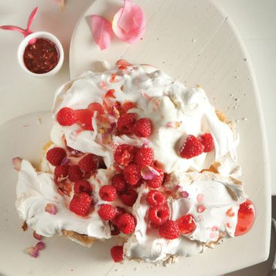 Rose pavlova with raspberries