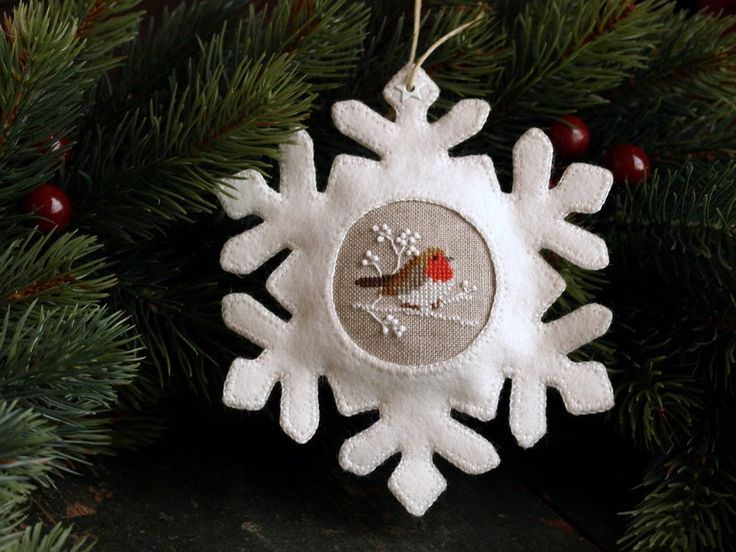 Cross-stitch and felted snowflake ornament.