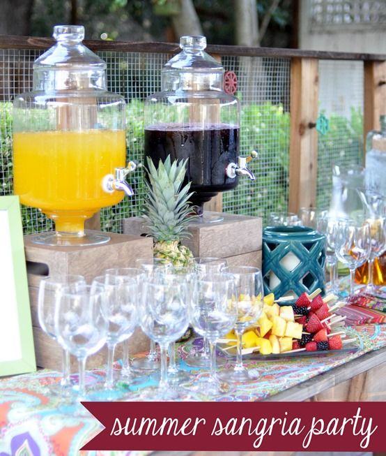 Simple Sangria Party by Centsational Girl: A) mix equal parts red wine + Blackberry Pomegranate Juice and serve with a raspberry-strawberry-blackberry skewer, or B) mix equal parts Pinot Gris + Orange Passionfruit Juice and serve with pineapple-peach-mango skewer drink stirrers (sparkling juices in glass bottles, apothecary jar beverage dispensers, stemware and linens from World Market)