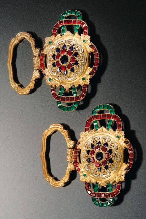 A PAIR OF GILT-METAL EMBELLISHED BELT BUCKLES-, QING DYNASTY, 18TH CENTURY each consisting of a central rosette inlaid with colored glass red and green which is suspended a quatrefoil mobile ring.