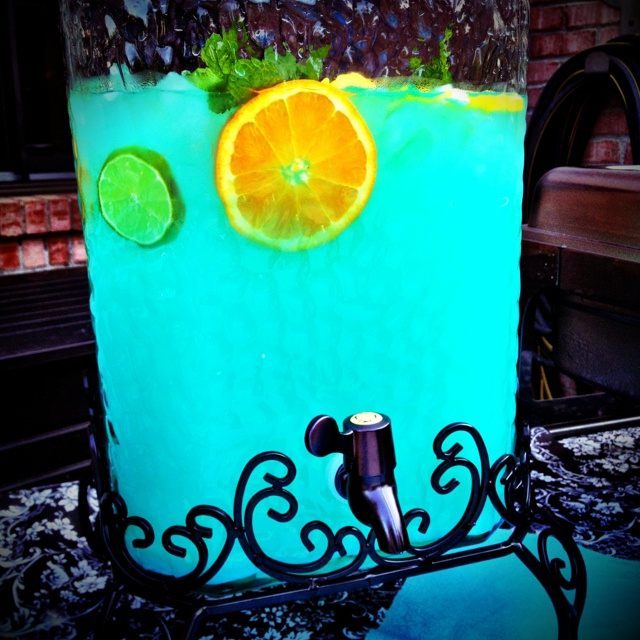Tiffany Punch. Equal parts blue Hawaiian Punch and Country Time Lemonade.  Love how the light shines through it and it looks like Caribbean water.
