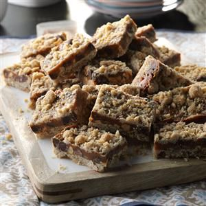 Caramel Peanut Bars Recipe -With goodies like chocolate, peanuts and caramel peeking out from between golden oat and crumb layers, these bars are very popular. They taste like candy bars but with irresistible homemade goodness. -Ardyce Piehl, Wisconsin Dells, Wisconsin