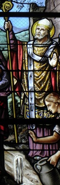 detail of a stained glass window of Saint Julian of Le Mans; date and artist unknown; church of Saint-Pierre de Chevaigné, France; photographed on 14 September 2013 by GO69; swiped from Wikimedia Commons; click for source image