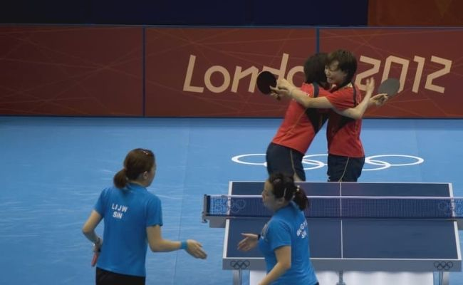 Olympic Table Tennis: The Women's Team of China Celebrate A Winning Point