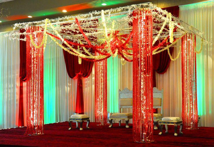 exotic crystal mandap with low hanging garland strands. #madap