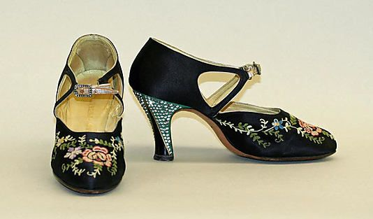 Evening shoes Saks Fifth Avenue  (American, founded 1924) Date: 1925–27 Culture: French (probably) Medium: silk, leather Dimensions: Heel to Toe: 8 1/2 in. (21.6 cm) Credit Line: Gift of Luise S. Davidson, 1975 Accession Number: 1975.76.2a, b This artwork is not on display