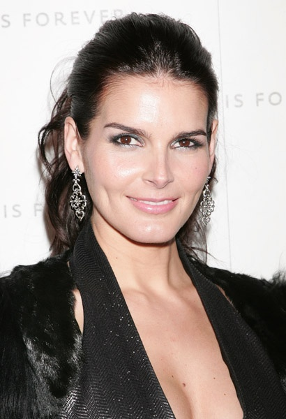 "Angela Michelle ""Angie"" Harmon (born August 10, 1972) is an American fashion model and television/film actress.  She became a well-known model before gaining international fame for her roles in Baywatch Nights and Law & Order.  Harmon was born in Dallas, Texas, the daughter of Daphne Demar (Caravageli) and Lawrence Paul ""Larry"" Harmon, a hospital information-network executive in Dallas.  Her mother is of Greek descent and her father is of English and Cherokee Native American ancestry."
