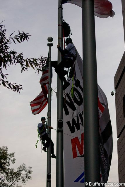 """Rainforest Action Network  Bank of America, Not With Our Money! Funding dirty coal? Not with our money. Activists hung a banner on Bank of America's Charlotte, NC headquarters to tell the bank: """"Not with our money!"""" People are fed up with Bank of Ame"""