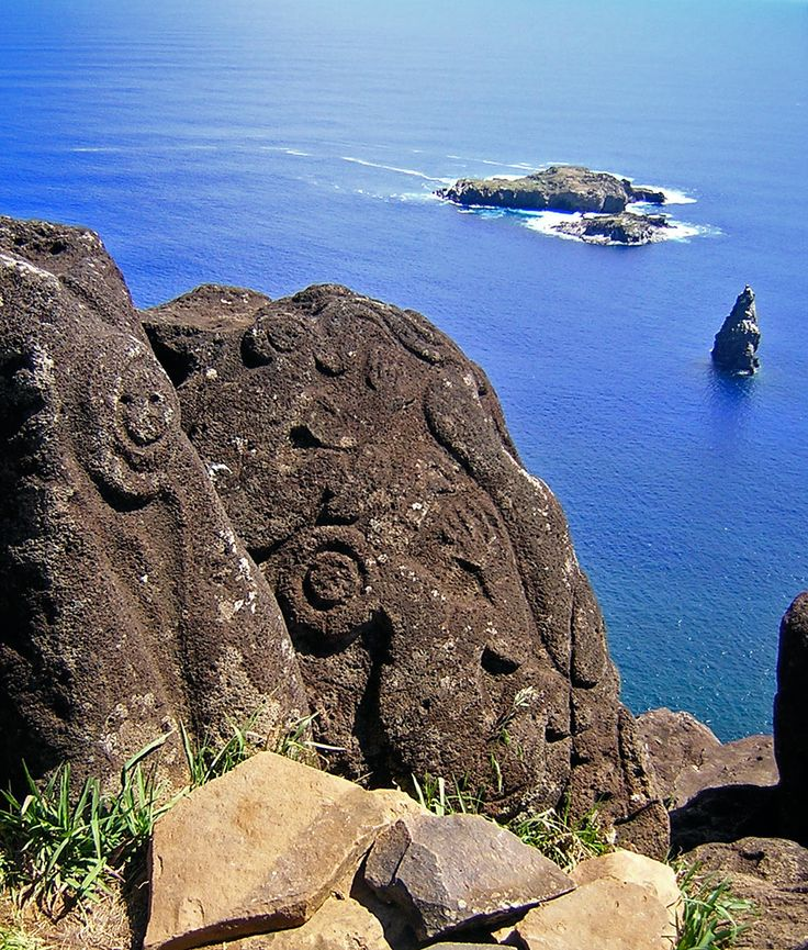 Orongo petroglyphs with Motu Nui islands in the background. isla de Pascuas.