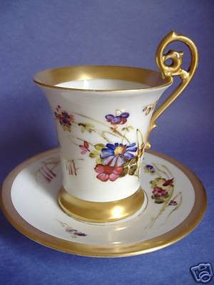 Up for auction is a lovely antique Limoges hand painted chocolate cup and saucer produced in the late 19th/early 20th century ~1892-1907. A wide band of rich gold gilding decorates the saucer's rim,