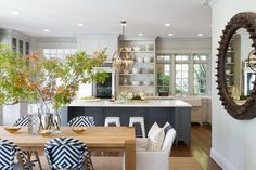 Benjamin Moore Edgecomb Gray for a Beach Style Kitchen with a Rustic Wheel Mirror and Open Plan Traditional- Modern Living for Today's Family by Heydt Designs