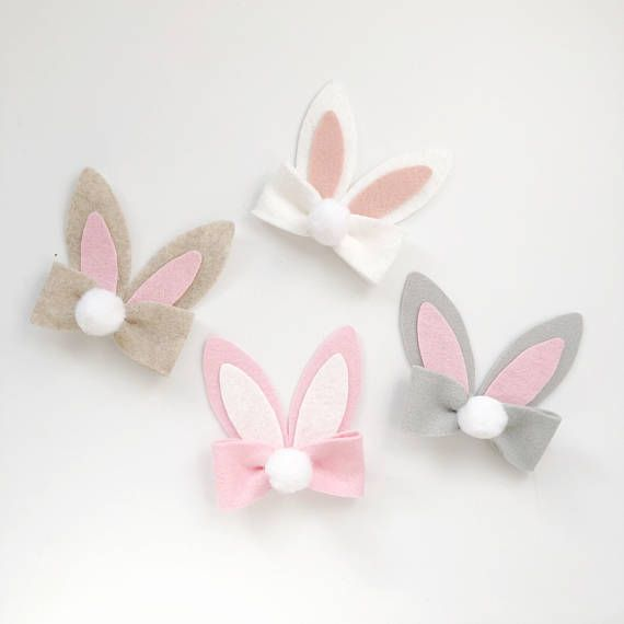 This adorable bunny bow, is perfect for any Easter outfit. Classic white bunny ears with a pink inside sit on a matching bow with a cute puffy white tail. Bow come attached to your choice of grosgrain lined alligator clip, one size nylon band, or a 1/8 skinny elastic headband.