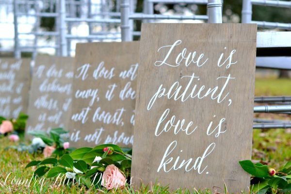 Featuring one of the most popular biblical love passages, these hand-lettered wood signs make beautiful aisle markers and lasting mementoes that can be displayed in your home after the wedding.