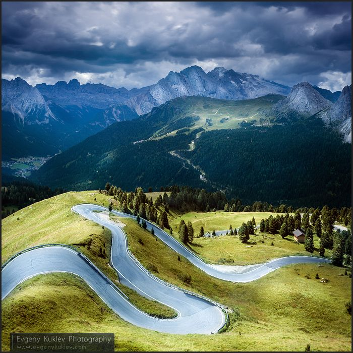 This road looks like it would be in a Disney cartoon and when the car drove up the road on the left it would bend as it passed over the crest of the hill..this is wilder than the curving pass I drove through in Switerland! Dolomites. Italy.
