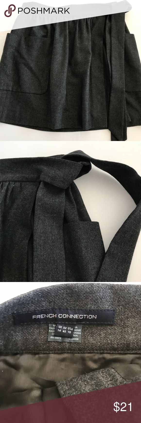 """French Connection Wrap Skirt Beautiful French Connection Skirt.... A deep Grey, it completely wraps around the waist, with poppers to secure it, and ties on the side. Little to no wearing. Perfect condition   Measurements  Waist 15.5"""" Length 17"""" French Connection Skirts A-Line or Full"""