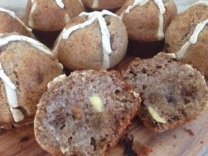 Gluten, sugar & dairy free Hot Cross Buffins fresh out of the oven buttered with grass fed organic butter
