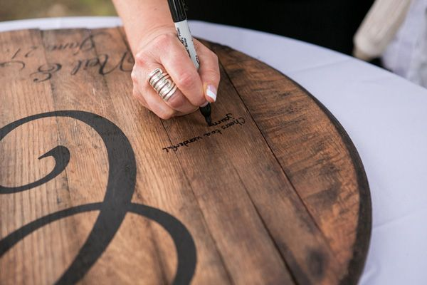 Signing a wine barrel instead of a guest book | Real SoMd Wedding: Family Friendly Vineyard Wedding | Southern Maryland Weddings | Photos by Amber Kay Photography #vineyardwedding #somdweddings
