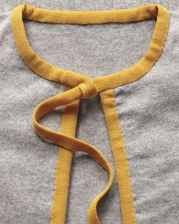 Sew binder tape to your cardigan for an easy color upgrade. - DIY - Lets Do This!