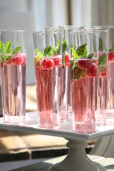 flutes of rosé champagne with raspberries and mint-if i can't think of a signature cocktail