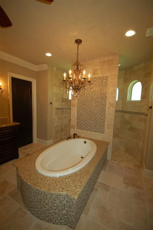 doorless, walk-in shower behind bath
