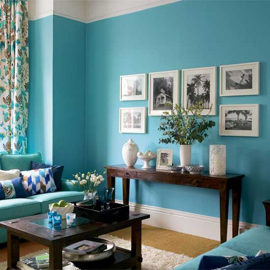 white picture frames on a blue wall - guest bedroom idea