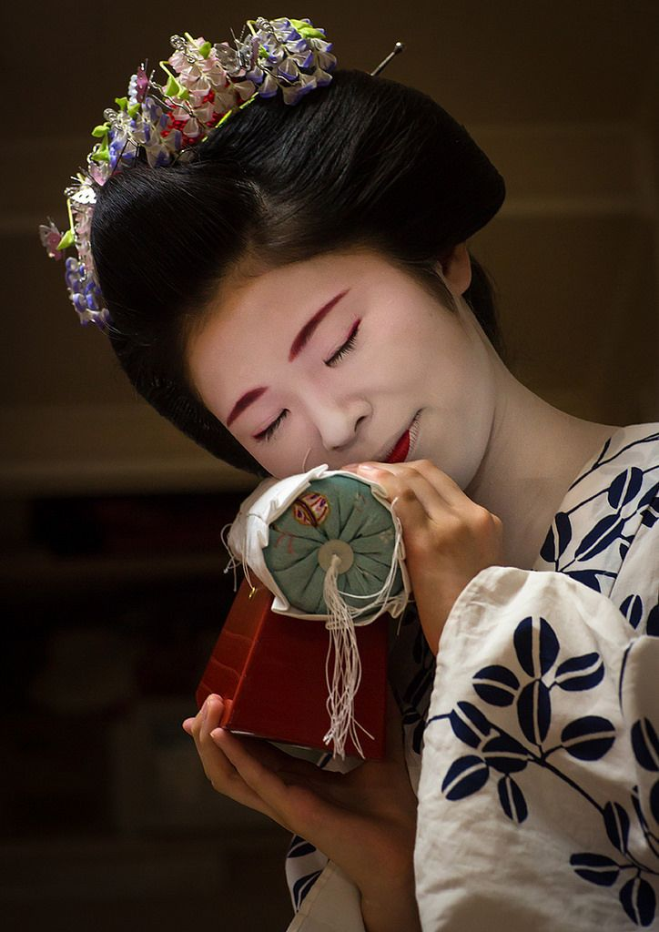 May 2016: first-year maiko Chikasaya with her takamakura - a special pillow to protect the Japanese hairstyles while sleeping by Eric Lafforgue on Flickr
