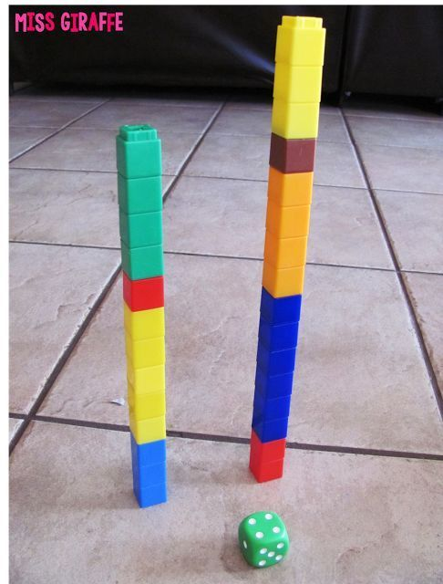 Stack It! math station where students take turns rolling the dice and adding that many cubes to their tower - whoever can make the tallest tower without falling wins! (Building Number Sense in First Grade blog post with a ton of ideas!!)