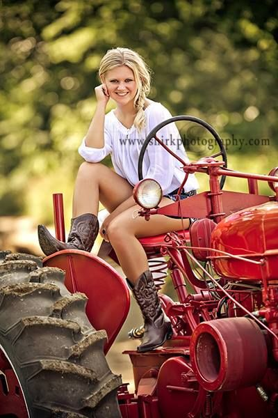 This senior brought in her grandfather's first tractor! It's great incorporating personal items into senior sessions!