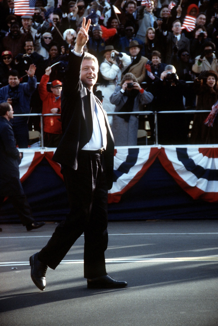 President William Jefferson Clinton waves to the crowd as he walks down Pennsylvania Ave. after his inauguration, January 20, 1993- from the Clinton Presidential Library