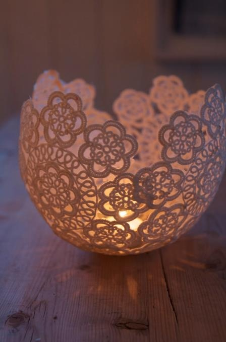 DYI. Use sugar starch and place doily around a balloon. Let it dry, then prick the balloon and remove.