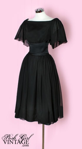 The flow of this dress is so pretty and modest. On top of that its my favorite party color, black.