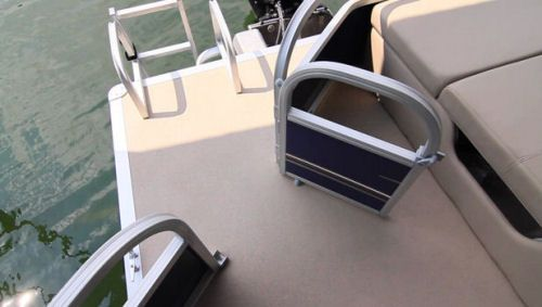 Sun Tracker Party Barge 22 XP3: A modest swim platform has a well-built reboarding ladder with high rails. The gate is angled providing more room at the platform and just ahead is an open area that provides plenty of room for getting ready to go in, or come out of the water.