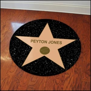 Hollywood theme- tape these on floor with guest's name on them. Buy rubber disk from $ store and spray paint black.