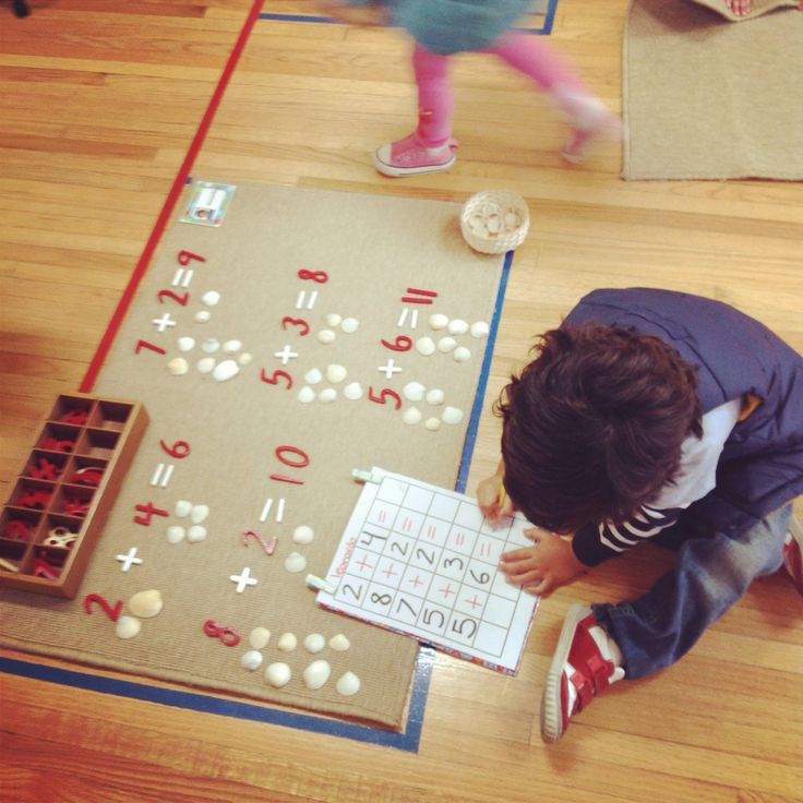 Montessori math exercises....I like the pic n name of kid on the corner so the teacher knows who working