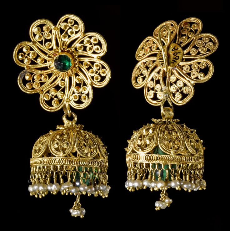Filigree ear ornament, one of a pair, the gold rosette set with a green glass stone, along the bottom of the bell-shaped part a fringe of pearls enclosing a green glass drop: Northern India, probably Bengal, mid 19th century