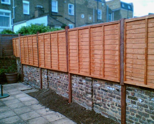 creative wooden fence on brick wall designs