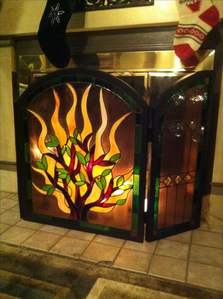 My fireplace... made by me, Vicky True-Baker. (Stained glass fireplace screen - fire, flames, tree)