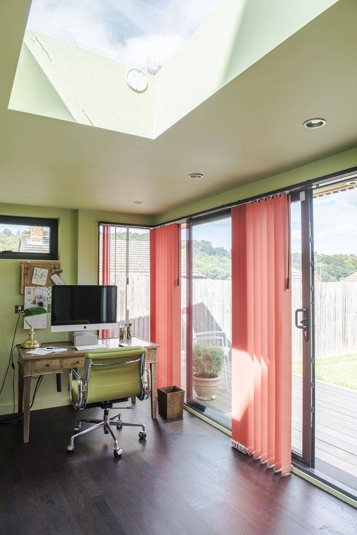 Style Studio's vertical blinds. Garden office. Orange vertical blinds. Prevent glare on the monitor on sunny days without obscuring the garden views.  Versatile window blinds. Contemporary window dressing. Orange colour inspiration for the home.