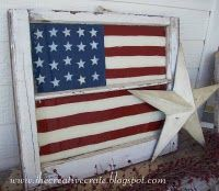 Tack an old quilt or flag behind an old window. Could change to suit the season/holiday