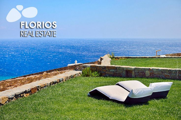 A garden, in front of the pool, with lawn and flowers completes an environment of relaxation and wellness, overlooking the sea and the beach of Elia. Villa for Sale on Mykonos island Greece. FL 1401 http://www.florios.gr/en/mykonos-property/10.html