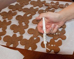 The struggle to ice gingerbread men cookies (more than one, anyway) is real. Get nice neat lines in a pinch with a syringe.   40 Ultimate Room Mom Hacks