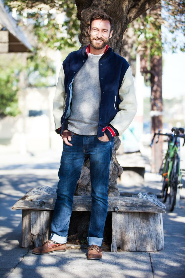 For an everyday outfit that is full of character and personality try teaming a navy and white bomber jacket with blue jeans. Round off this look with brown leather boat shoes.  Shop this look for $127:  http://lookastic.com/men/looks/grey-crew-neck-sweater-blue-jeans-brown-boat-shoes-navy-and-white-bomber-jacket/6880  — Grey Crew-neck Sweater  — Blue Jeans  — Brown Leather Boat Shoes  — Navy and White Bomber Jacket