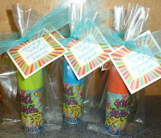 "The fun one is silly string from the Dollar Tree in a plastic gift bag, tied with aqua tulle, & a ""Have a silly summer!"" tag."