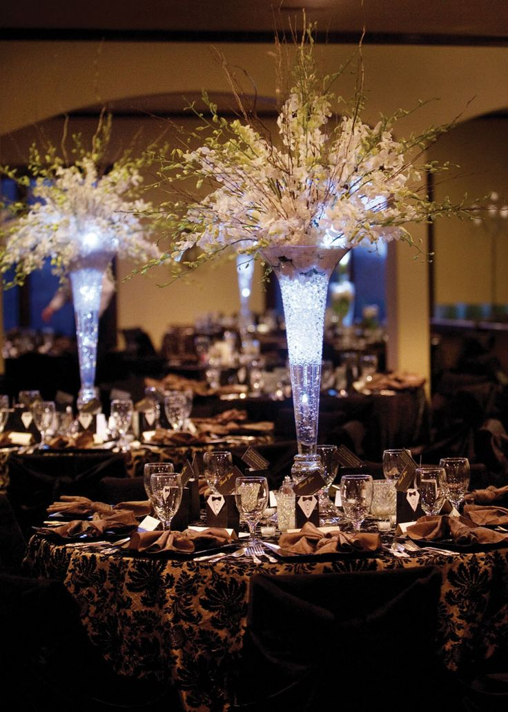 Tall Wedding Centerpieces | But with a Deep purple light in centerpieces. I even like the table cloths