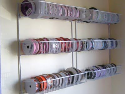 Closetmaid pantry shelving to store ribbon spools is better than the dowel or hanger system because spools can easily be removed. My favorite storage is this one, and the ribbon card from cropper hopper.
